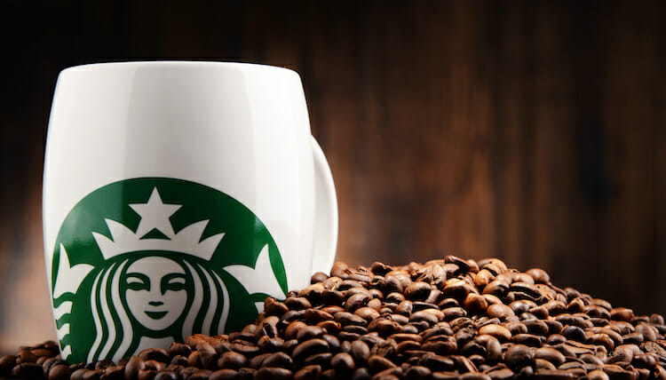 Cup of Starbucks with coffee beans